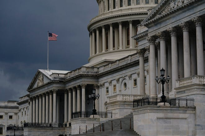 The federal budget deficit is projected to hit a record $3.3 trillion as huge government expenditures to fight the coronavirus and to prop up the economy have added more than $2 trillion to the federal ledger, the Congressional Budget Office said Wednesday.