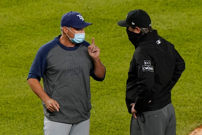 Tampa Bay Rays manager Kevin Cash, left, points as he talks to an umpire after New York Yankees relief pitcher Aroldis Chapman fired a 105 mph pitch at the Rays pinch hitter Michael Brosseau in the top of the ninth inninng of a baseball game Tuesday at Yankee Stadium in New York. The Rays and the Yankees have a history of throwing at each other in the past few years. Cash was suspended one game after the incident after benches cleared in the wake of the pitch. Chapman was suspended three games.