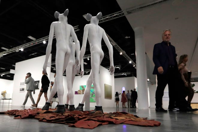 A sculpture by artist Jane Alexander with the Stevenson Gallery is shown during the December 2019 Art Basel Miami Beach, in Miami Beach. According to a statement released Wednesday the Art Basel fair, known for glamorous parties and celebrity sightings, is canceling its annual Miami event amid the coronavirus pandemic.