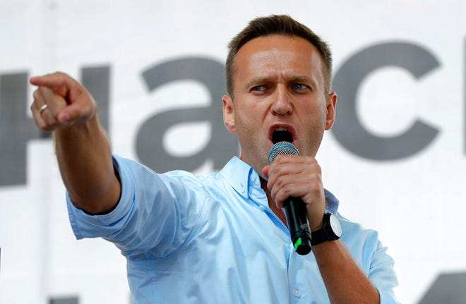 In this Saturday, July 20, 2019, file photo, Russian opposition activist Alexei Navalny gestures while speaking to a crowd during a political protest in Moscow, Russia. Russian opposition leader Alexei Navalny was the victim of an attack and poisoned with the Soviet-era nerve agent Novichok, the German government said Wednesday, citing new test results. Navalny, a politician and corruption investigator who is one of Russian President Vladimir Putin's fiercest critics, fell ill on a flight back to Moscow from Siberia on Aug 20 and was taken to a hospital in the Siberian city of Omsk after the plane made an emergency landing.