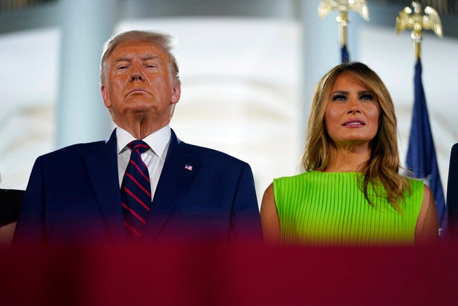 President Donald Trump and first lady Melania Trump stand on stage on the South Lawn of the White House on the fourth day of the Republican National Convention, Thursday, Aug. 27, 2020, in Washington.