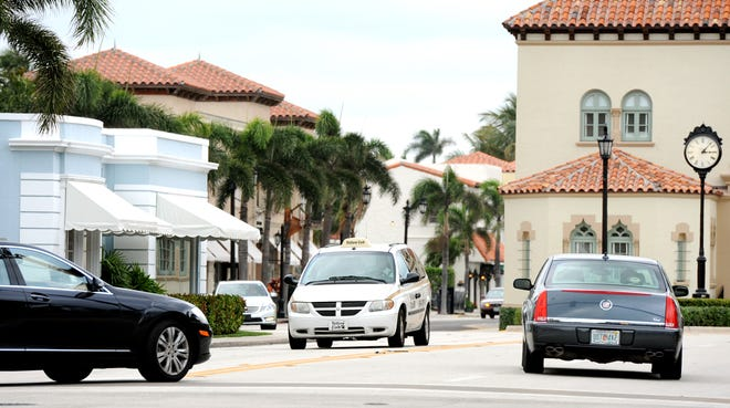 A Yellow Cab drives south on South County Road. [MEGHAN MCCARTHY/PALMBEACHDAILYNEWS.COM]