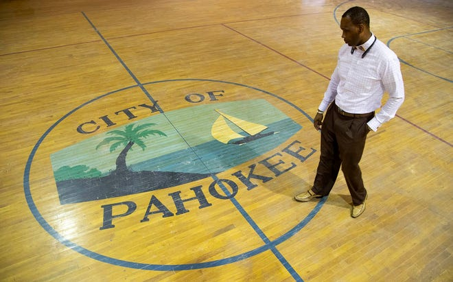 Pahokee City Manager Chandler Williamson, a lightning rod for criticism after five years at the helm of the predominantly Black lakeside city, walks July 24 through a gymnasium undergoing renovation with city assistance.
