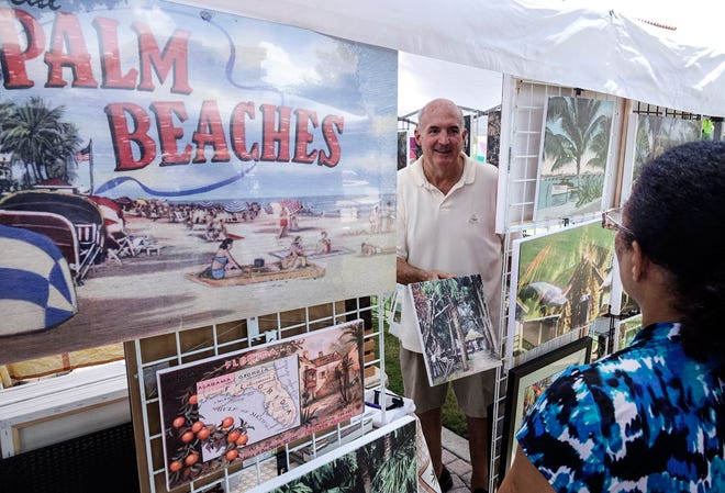 Jefferson Blakeslee of Palm Beach Native chats about his vintage images with a visitor to his booth at the Mango Festival in downtown Lake Worth June 2018.