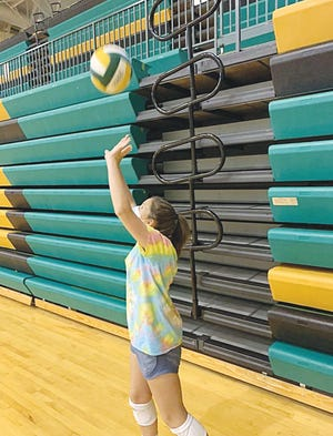 PHS sophomore Breckyn Millers sets the ball during a Greenback practice.