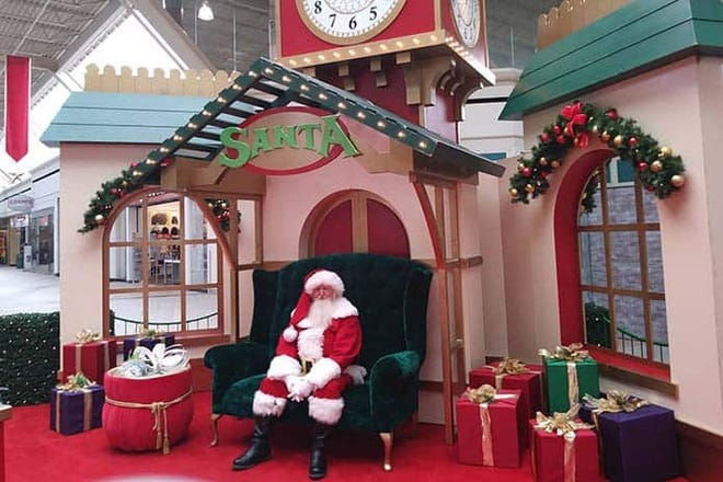 Santa Claus sits in his chair waiting to hear children's Christmas wishes in this undated photo.
