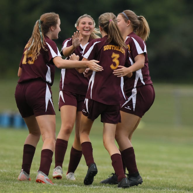 Southeast players celebrate freshman Emmi Smallfield's goal in the first half of the game against the Garfield G-Men.