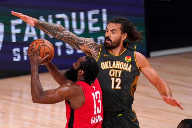 Houston's James Harden (13) goes up for a shot as Oklahoma City Thunder's Steven Adams defends during the second half of Monday's playoff game in Lake Buena Vista, Fla. The two teams meet again in Game 7 of their first-round series Wednesday night. (AP Photo/Mark J. Terrill)