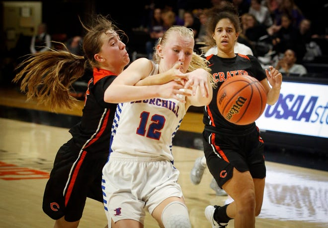 Churchill's Danika Starr (12) tries to control the ball as Crater's Presley Robison defends on the play late in the fourth quarter of their Class 5A quarterfinal game in March at Gill Coliseum in Corvallis. [Andy Nelson/The Register-Guard] - registerguard.com