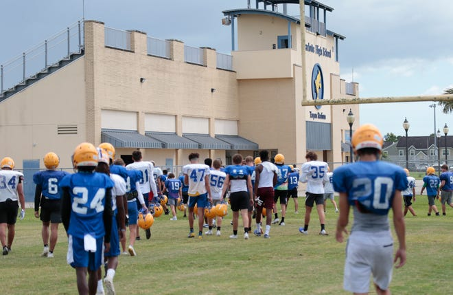 The Charlotte High football team is chased back into the locker room after the lightning meter went off during practice last week.