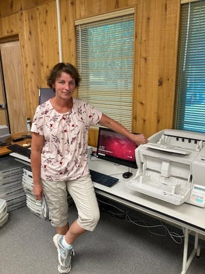 Siskiyou County Clerk Laura Bynum stands next to one of the central count scanners where Siskiyou County's vote by mail ballots are tabulated.