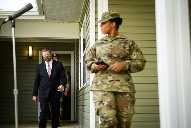 Secretary of the Army Ryan McCarthy walks out of a renovated home to speak to the media Wednesday on Fort Bragg.
