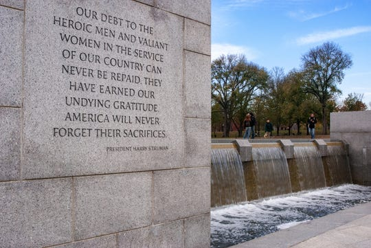 """A view of the inscribed quote by President Harry Truman beginning, """"Our debt to the heroic men and valiant women..."""" at the World War II Memorial in Washington DC."""