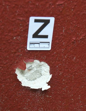 A bullet hole with an evidence marker near where a woman was fatally shot Tuesday evening at Candlewood Apartments on Fiske Blvd., just south of Dixon Blvd. in Cocoa.