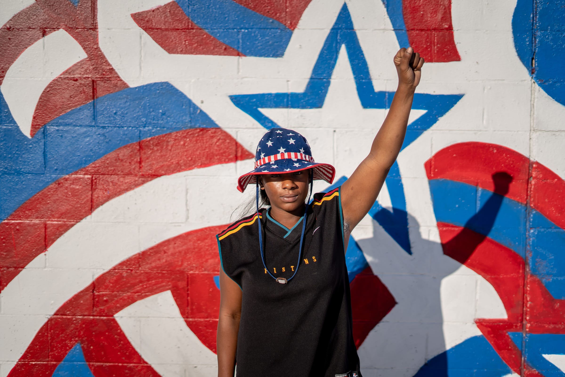 Shaqualla Johnson of Detroit poses for a photo at Veterans Park in Hamtramck on Thursday, August 20, 2020 before the start of a march through the streets for Justice for Yemen march.