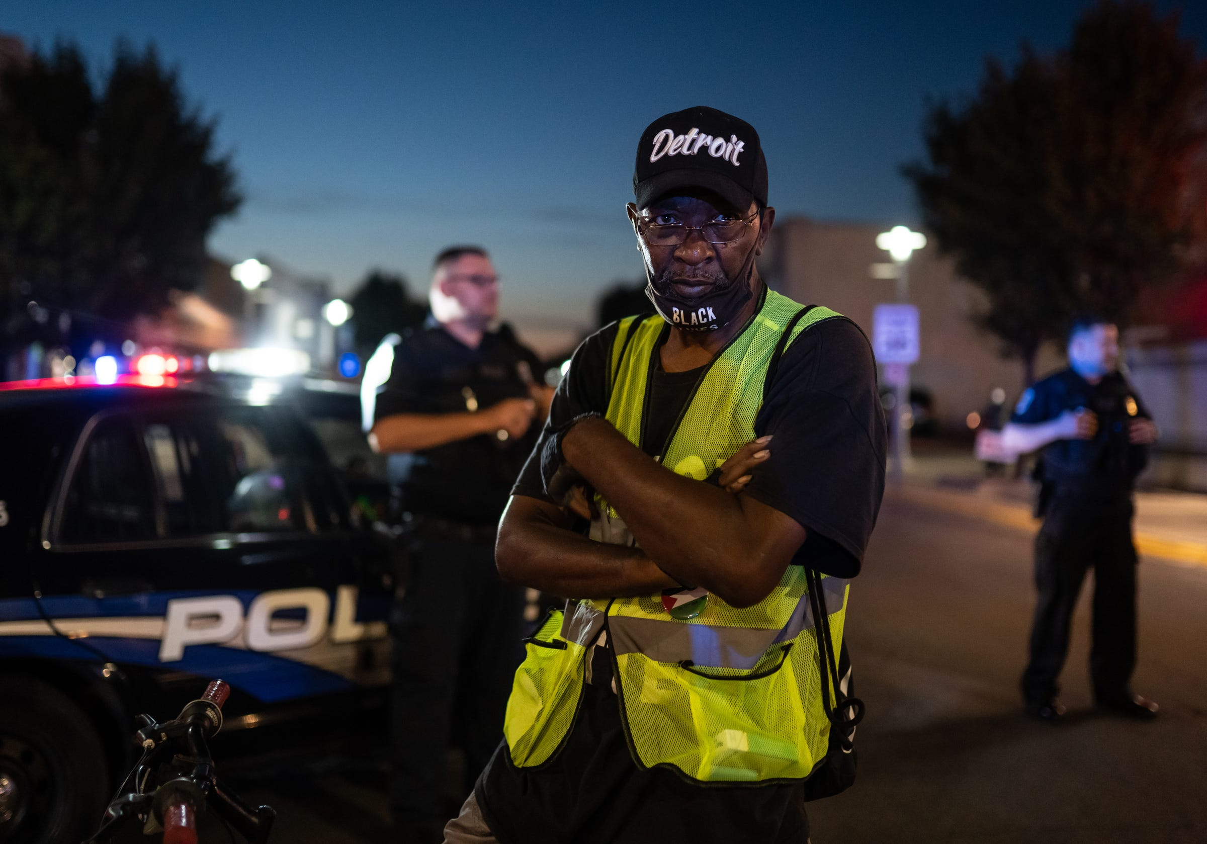 Darnell Grant of Detroit helps block the path with his bike as Hamtramck Police stand by during the Justice for Yemen march in Hamtramck on Thursday, August 20, 2020.