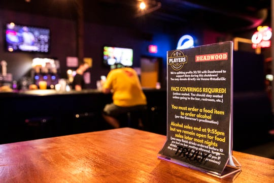 A sign lists COVID-19 requirements inside Players Sports Bar & Grill, Wednesday, Sept. 2, 2020, at 219 Iowa Avenue, in Iowa City, Iowa.