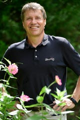 Dan Hurst, founder of Strata-G, the largest veteran-owned business in East Tennessee, poses for a portrait at the company's butterfly garden in Knoxville on Aug. 2, 2020. The company was recently sold to two key employees.