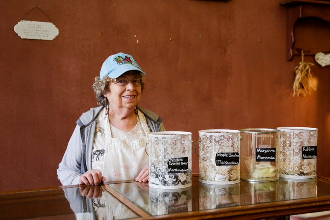 Kathy Logsdon, owner of Kathy's Kandies, stands behind a case in her Main Street candy shop, Wednesday, Sept. 2, 2020 in Lafayette. Logsdon and Kathy's Kandies is closing this weekend after 20 years in Lafayette.