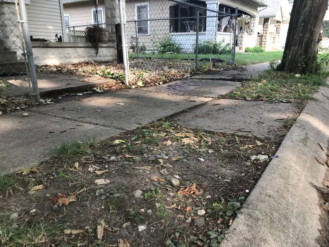 A view of the area were police say two men were killed late Monday night on the 1900 block of North 16th Street, Tuesday, Sept. 1, 2020 in Lafayette. According to police, officers found the two men dead in the street in the 1900 block of North 16th Street, between Hart and Burroughs streets, after getting a report of shots fired at 11:14 p.m. Monday.  Alberto Vanmeter, 19, Lafayette, died on this sidewalk, and Domino's PIzza deliveryman Joshua Ungersma died a few feet away in the street. Ungersma told a witness that  Vanmeter tried to rob him, and then Vanmeter's suspected accomplice, a 17-year-old girl, shot Vanmeter, according to the witness.