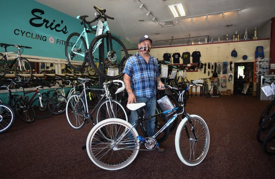 """Eric Clark, owner of Eric's Cycling & Fitness in south Lansing, pictured Wednesday, Sept. 2, 2020.  He says new bike sales and repairs have been historically high for his shop since COVID-19 began.  """"I sold bikes I've had since 2013, and usually have 130 in back stock, but those are gone."""""""