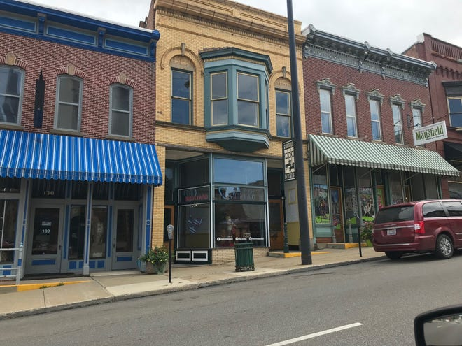 Downtown Mansfield Inc. will be showcasing its newly renovated building at 128 N. Main St., center, on Friday and Saturday.