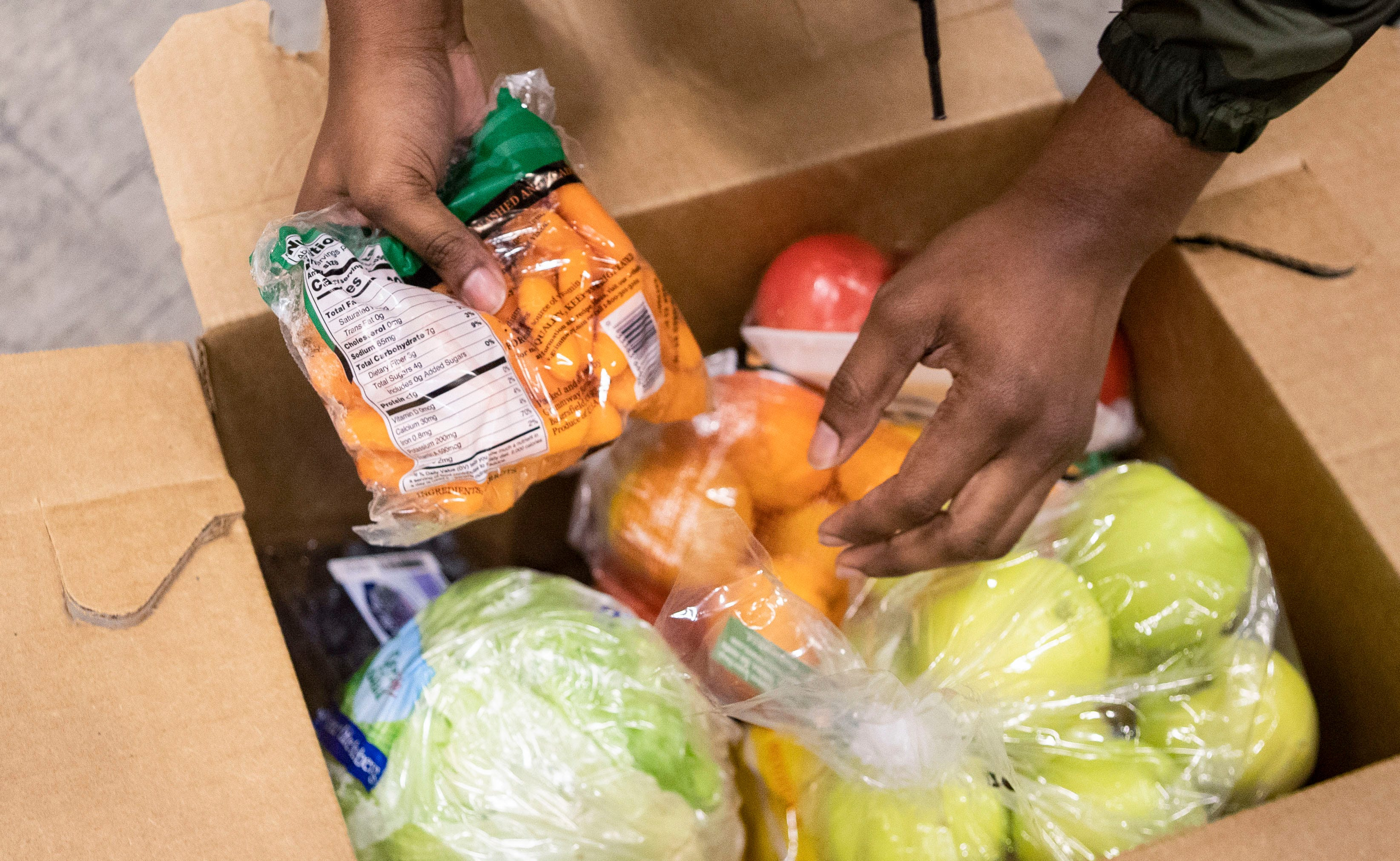 Warehouse manager Anthony Walls checks the quality of  inventory at the food bank warehouse at the Mid-South Food Bank in Memphis, Tenn., on Tuesday, September 1, 2020.