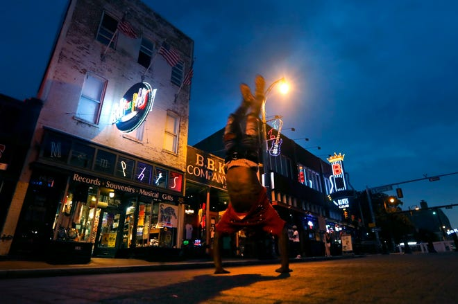 Clarence Henderson flips down Beale Street after sunset on Tuesday, Sept. 1, 2020.