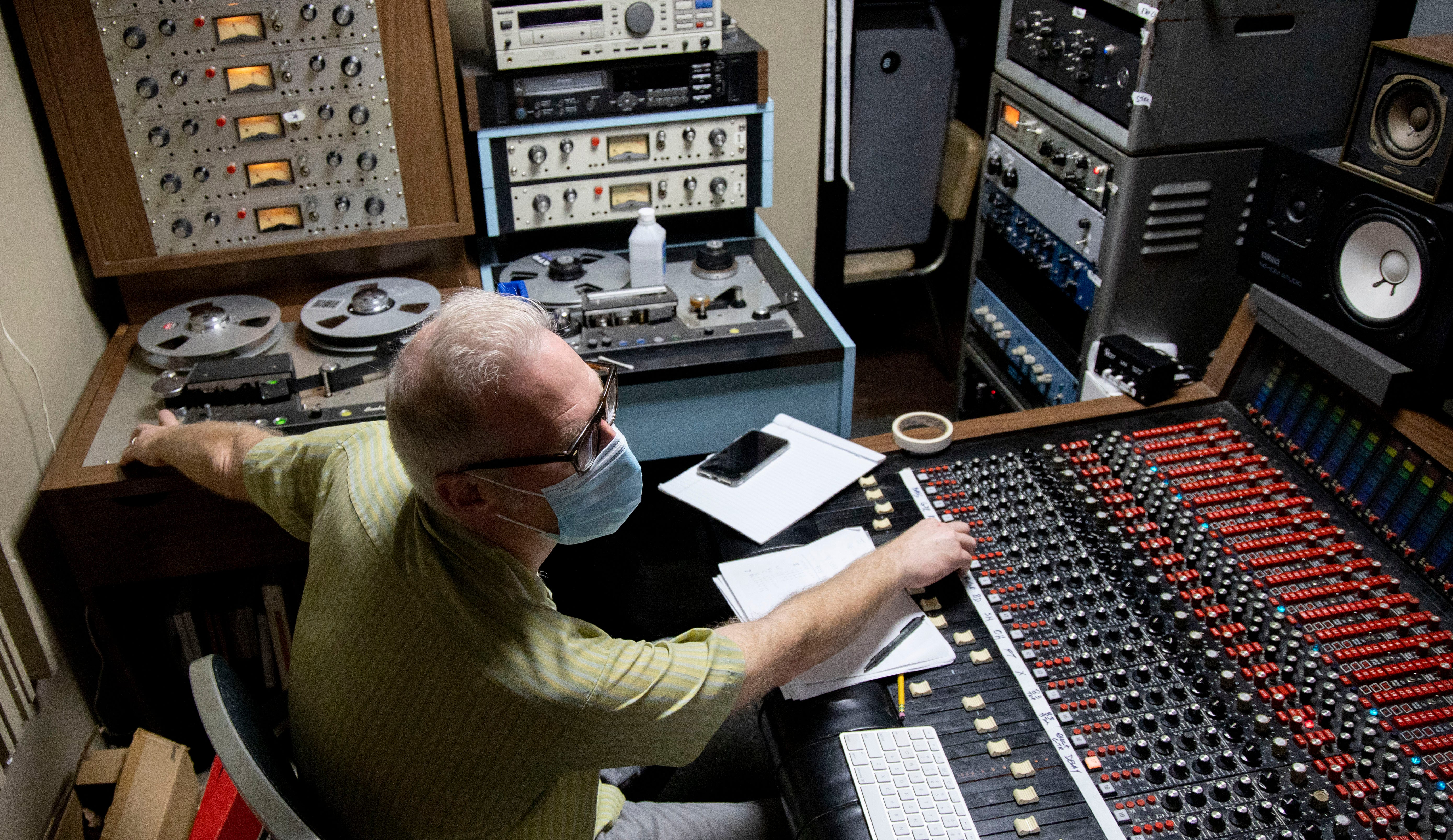 Scott Bomar works the console and tape machine while recording Greg Cartwright's harmonica track for Reigning Sound's album Tuesday, Sept. 1, 2020, at Electraphonic Recording in Memphis.