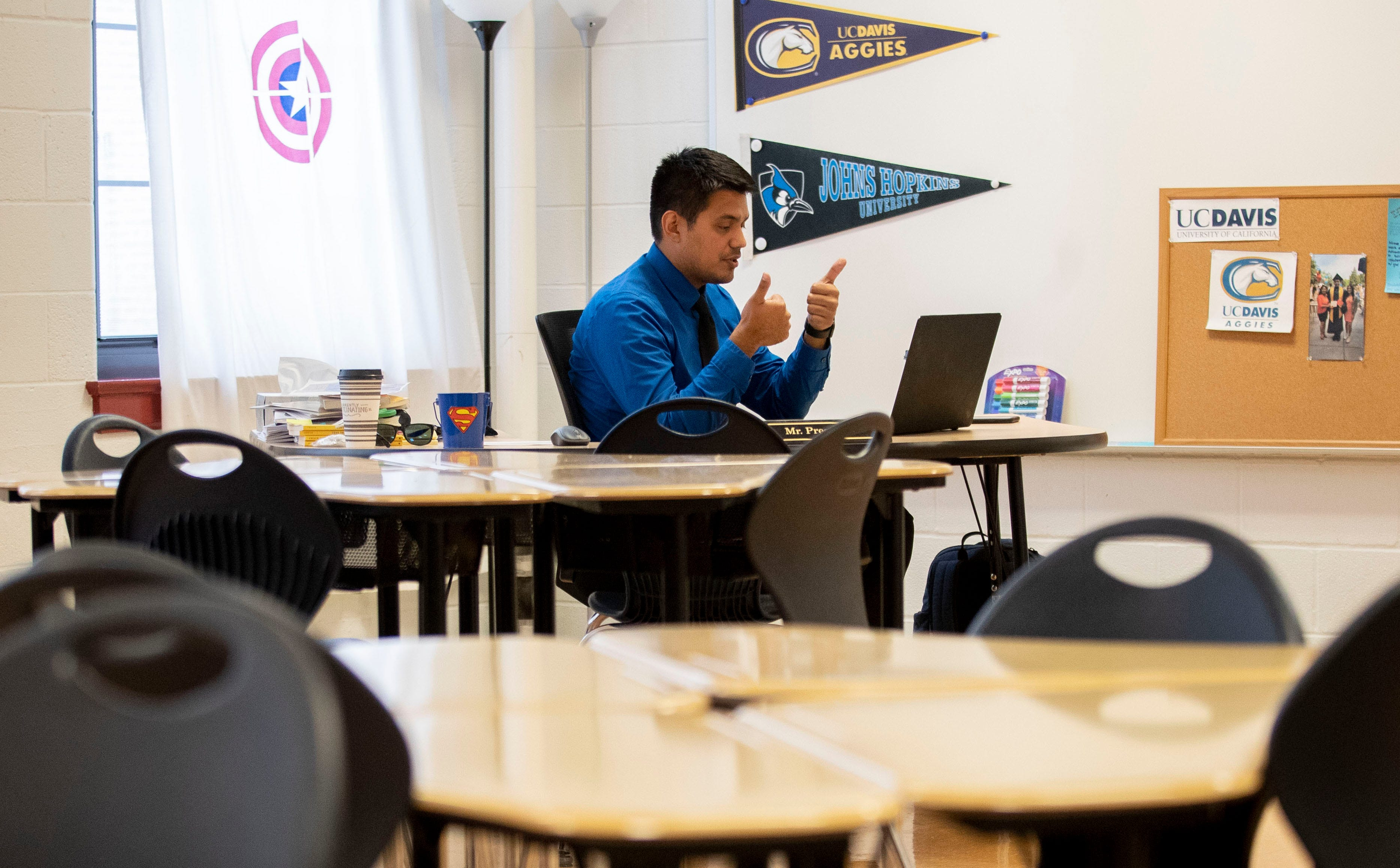 Fidel Prestegui talks with his fourth grade reading class about what type of information is safe to share online Tuesday, Sept. 1, 2020, at Vision Preparatory Charter School in Memphis. Prestegui works out of his classroom while instructing his students remotely.