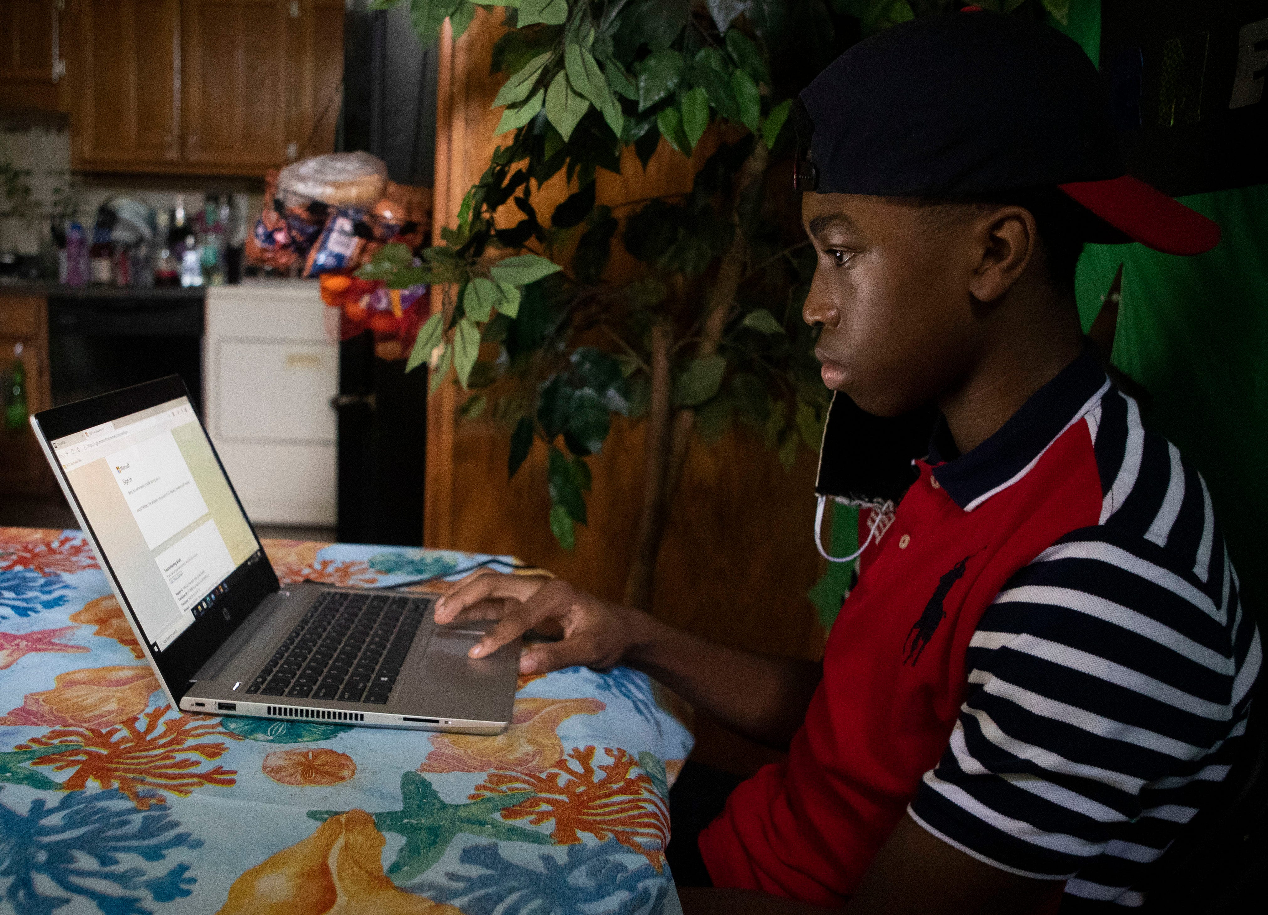 14-year-old Emerson Tenner takes a virtual class in his kitchen in Memphis, Tenn., on Tuesday, September 1, during the new 2020-2021 due to the presence of the coronavirus.