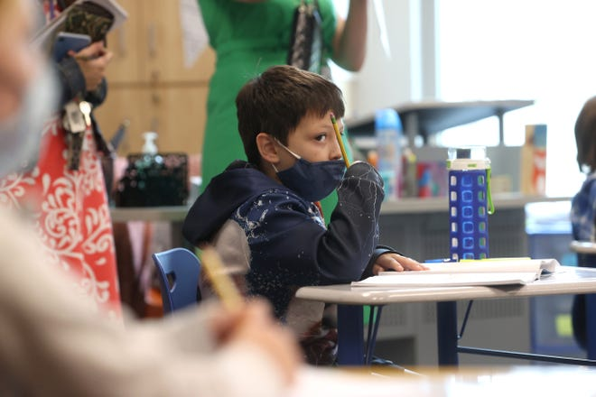 Students watch as guests enter their 3rd grade classroom with Tennessee Education Commissioner Penny Schwinn during a visit to Forest Hill Elementary School on Wednesday, Sept 2, 2020.