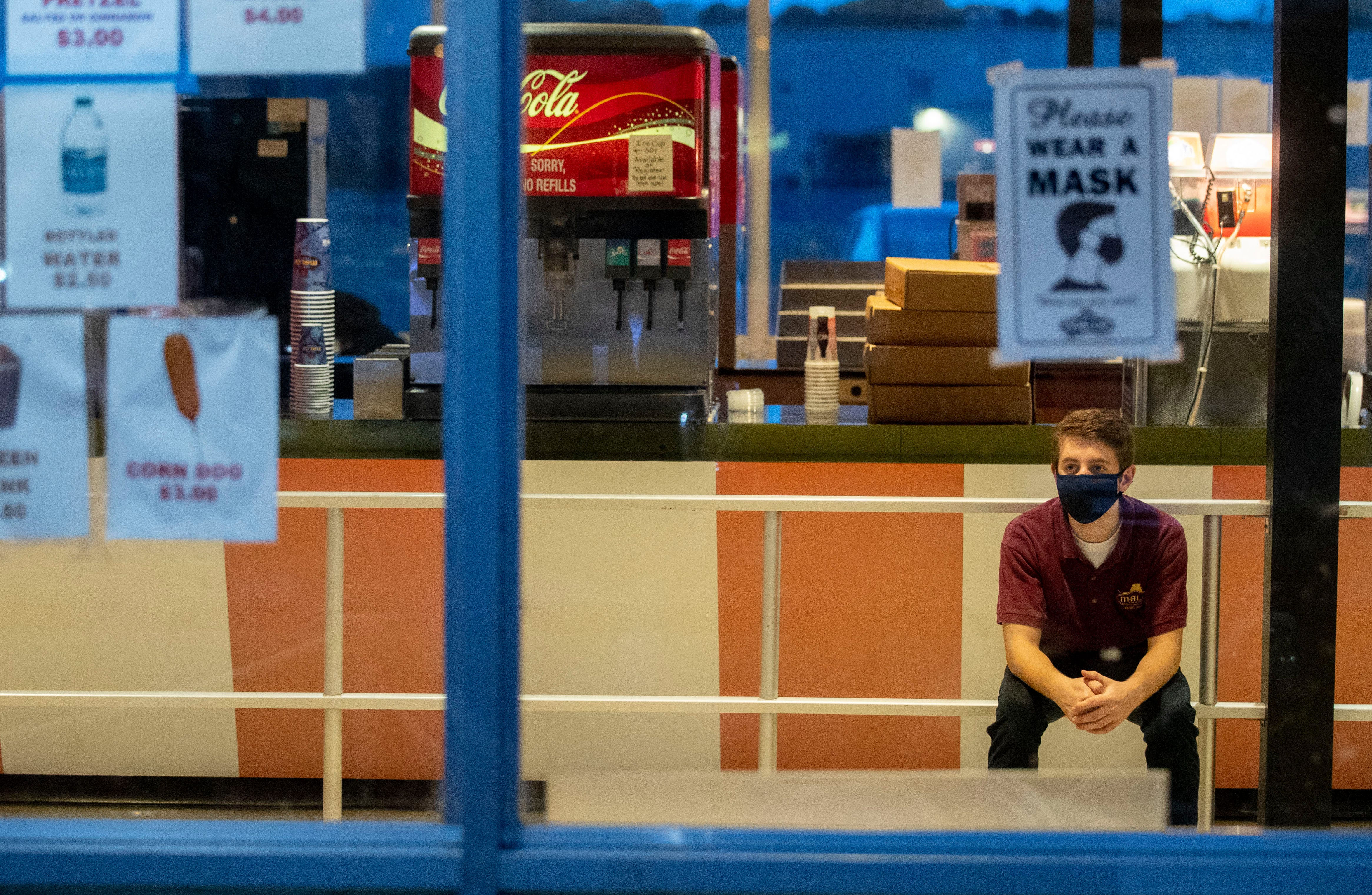Jacob Roberts, 19, of Memphis, waits in the concessions building for customers Tuesday, Sept. 1, 2020, at Malco Summer Quartet Drive-In in Memphis. Roberts worked at the Malco Forest Hill location and was transferred to the drive-in during the pandemic.