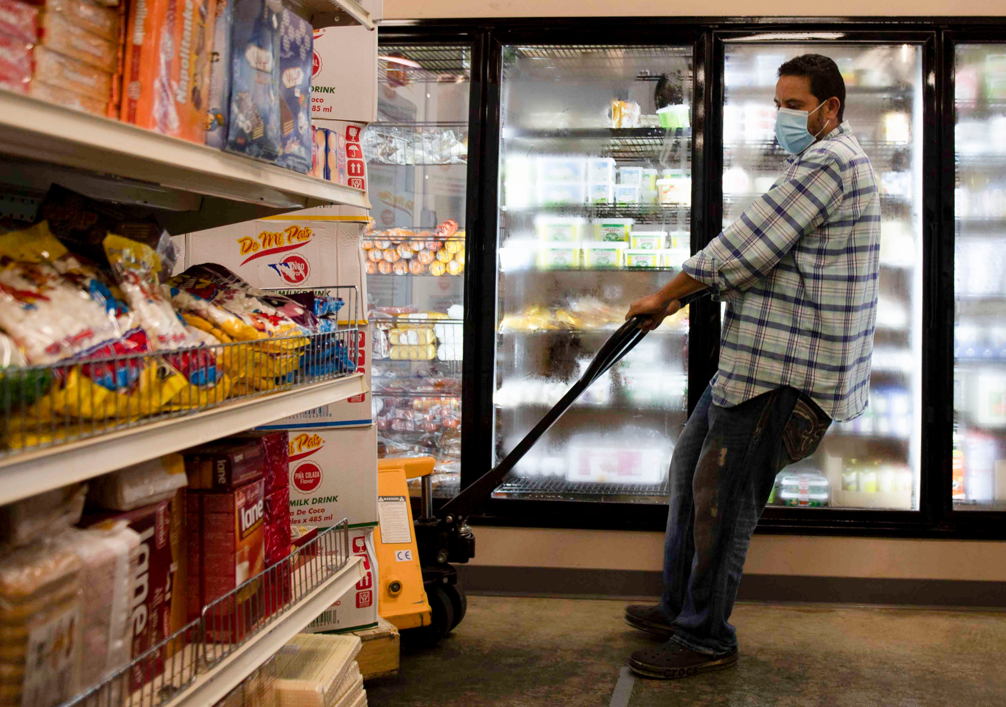 Tamar Eldahan moves the boxes around Alrahmah Mediterranean Grocery in Cordova on Tuesday, Sept. 1, 2020. The Eldahan family has owned the business for 12 years and has served their community in Memphis despite the pandemic and have provided them with essential products.