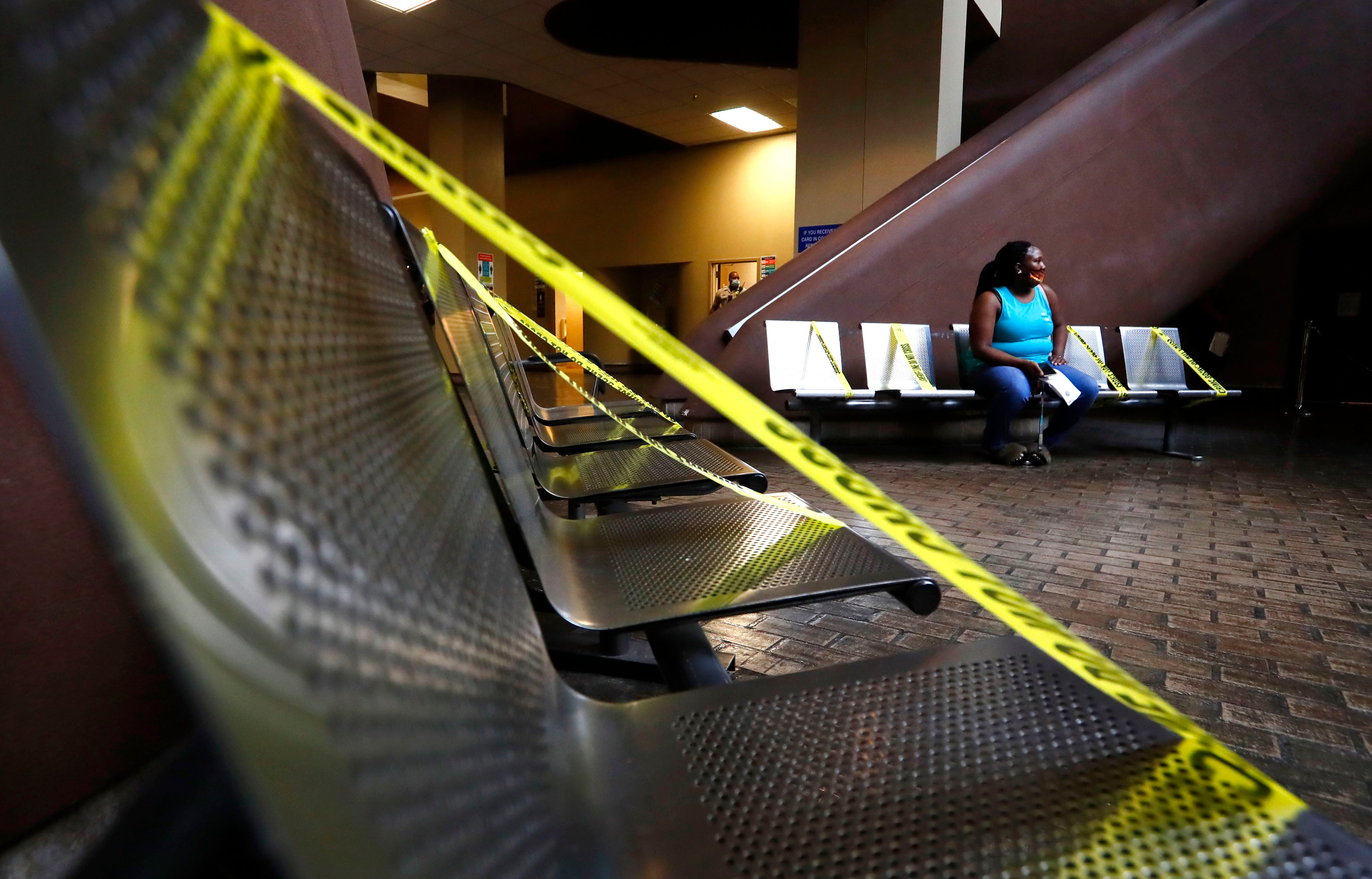 People file in to the lower floor where social distance markers seperate the waiting area seats at the Shelby County Courthouse just after 9am on Sept. 1, 2020.