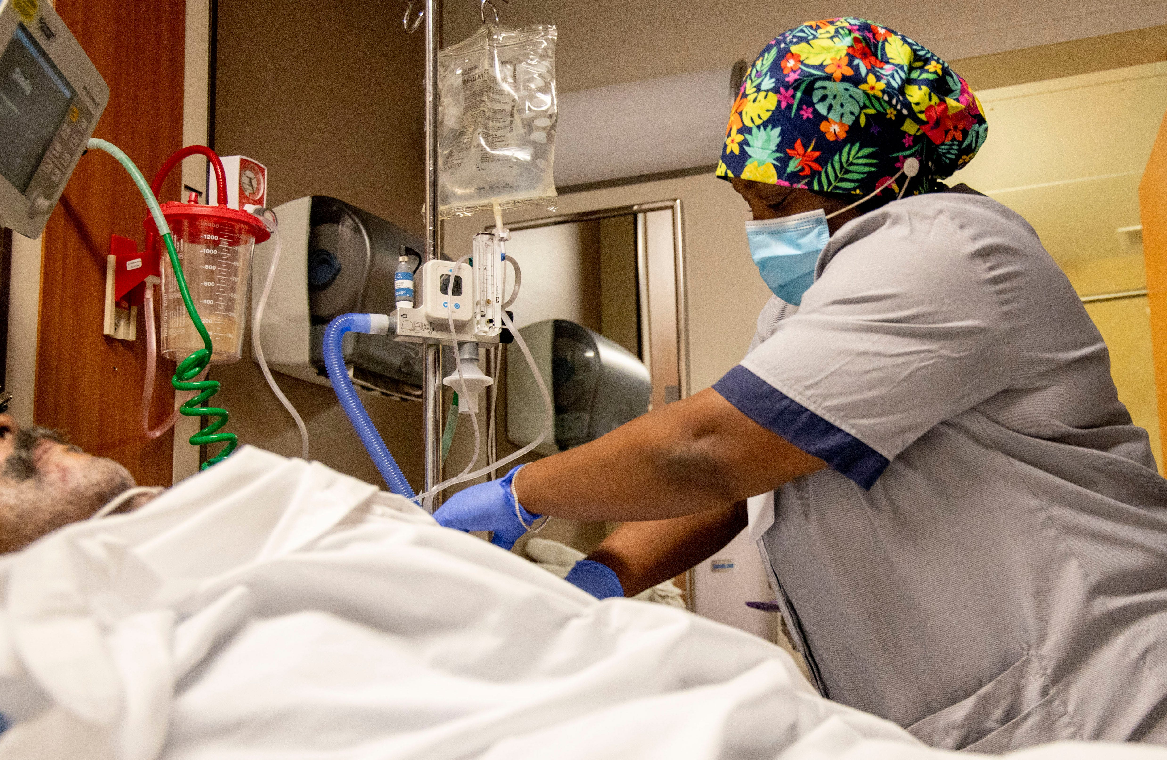 Attendant Keisha Thomas wipes down contact surfaces while cleaning a patient's room Tuesday, Sept. 1, 2020, at Methodist North Hospital in Memphis.