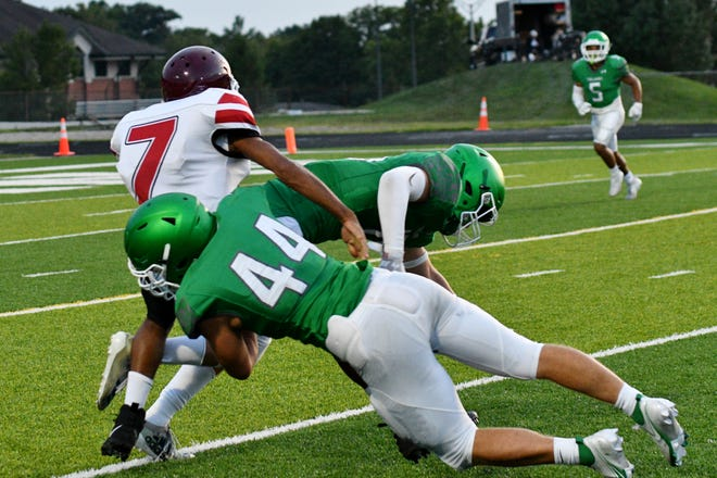 New Castle's Matt Bell (No. 44) makes a tackle during a game against Indianapolis Tindley at New Castle High School Aug. 29, 2020.