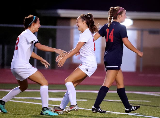 Stewarts Creek's Kinley Buena (11), center, celebrates her goal with Stewarts Creek's Hannah Opie (2), left as Oakland's Shannon O'Bryan (14) walks away on Tuesday, Sept. 1, 2020, at Oakland.