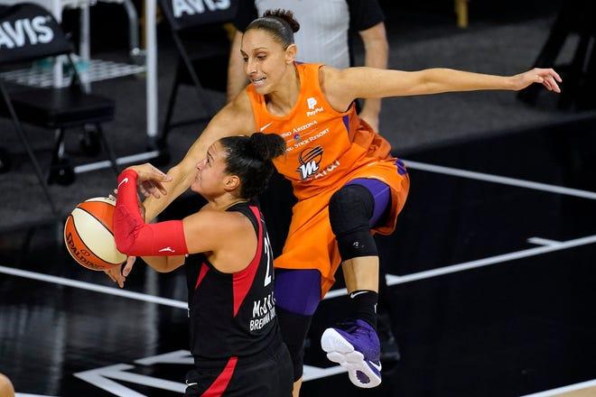 Las Vegas Aces guard Kayla McBride (21) has her shot blocked by Phoenix Mercury guard Diana Taurasi during the first half of a WNBA basketball game Tuesday, Sept. 1, 2020, in Bradenton, Fla. (AP Photo/Chris O'Meara)
