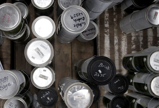 Cans of paint sit on pallets at the Habitat for Humanity Restore in San Angelo on Wednesday, Sept. 2, 2020.