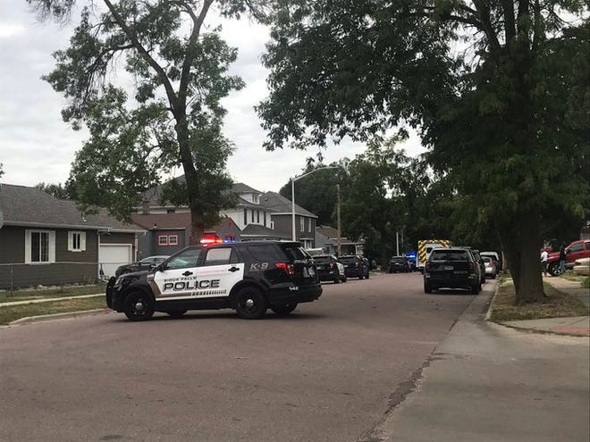 Police investigate a shooting on W. 13th Street on Tuesday morning.
