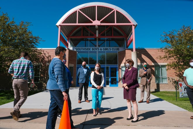 U.S. Sen. Amy Klobuchar talks with people during a visit Wednesday, Sept. 2, 2020, at the Southside Boys and Girls Club in St. Cloud.