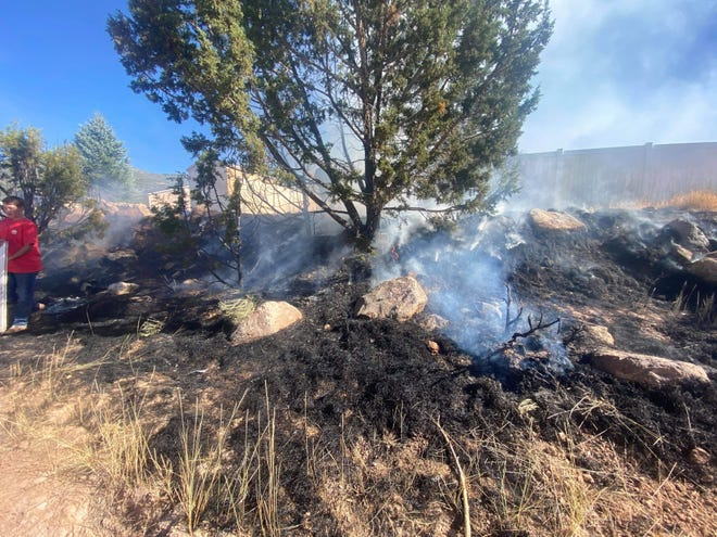 Neighbors work together to put out a fire near a walking trail in Cedar City. Sept. 1, 2020.