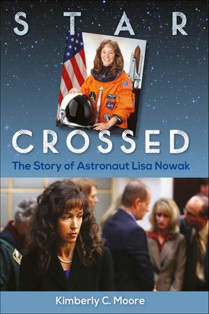 """Star Crossed: The Story of Astronaut Lisa Nowak"" is by Kimberley C. Moore."