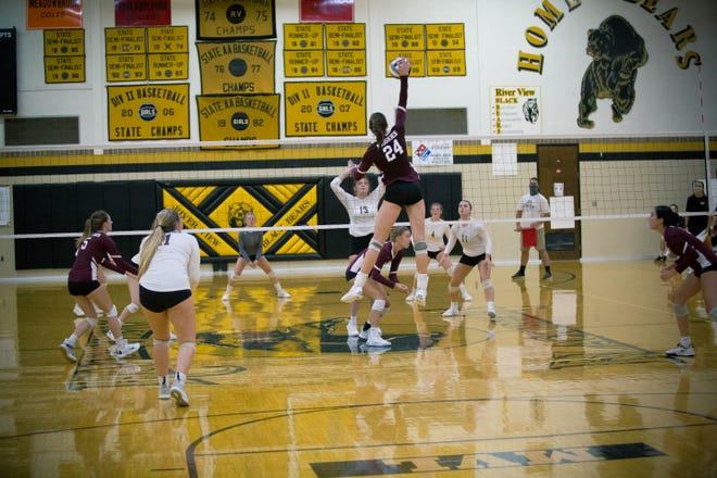 John Glenn senior Abigail Walker elevates high above the net for a kill during the match on Tuesday with River View.