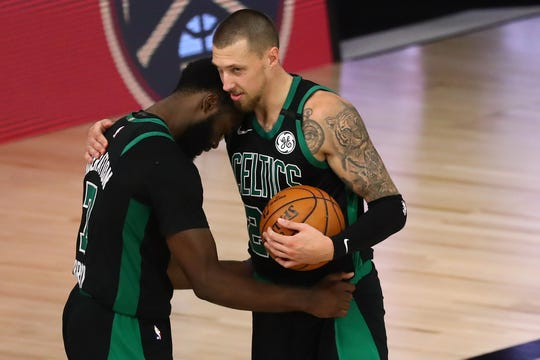 Boston Celtics guard Jaylen Brown (left) celebrates with center Daniel Theis (right) after defeating the Toronto Raptors in Game 2 of the second round of the 2020 NBA Playoffs at ESPN Wide World of Sports Complex.
