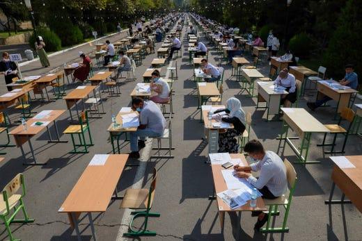 Uzbek students take open-air entrance exams in Tashkent on September 2, 2020, amid the ongoing coronavirus disease pandemic.
