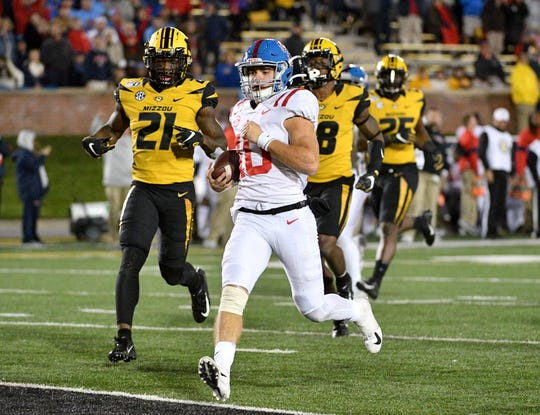 Mississippi quarterback John Rhys Plumlee runs in for a touchdown against Missouri during their 2019 game at Memorial Stadium/Faurot Field.