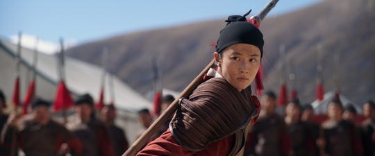 "Disguised as a man, Mulan (Yifei Liu) gets trained as a soldier in the Chinese army in Disney's live-action ""Mulan."""