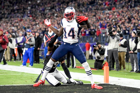 New England Patriots wide receiver Mohamed Sanu (14)  runs the ball in for a touchdown after a catch during the second quarter against the Baltimore Ravens at M&T Bank Stadium.